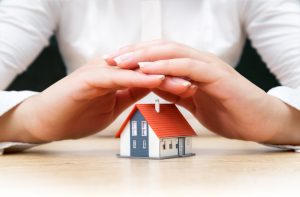 House,Covered,Of,Woman,Hands,-,Insurance,Real,Estate,Concept